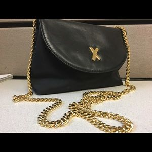 Paloma Picasso black bag with gold chain.
